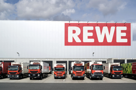 Trucks at REWE distribution center. REWE operates approximately 3,300 supermarkets in Germany.