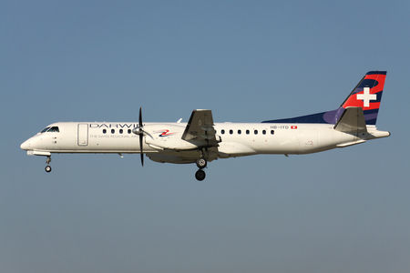 Swiss Darwin Saab 2000 with registration HB-IYD on short final for runway 14 of Zurich Airport. Darwin ceased operations on 12 December 2017.