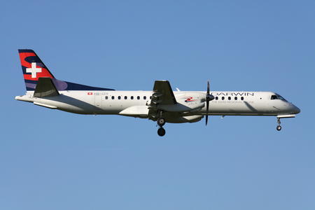 Swiss Darwin Saab 2000 with registration HB-IZH on short final for runway 14 of Zurich Airport. Darwin ceased operations on 12 December 2017. 写真素材 - 111544574