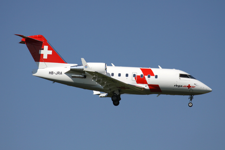 Swiss Air Ambulance Rega Bombardier Challenger 604 with registration HB-JRA on short final for runway 14 of Zurich Airport. Publikacyjne