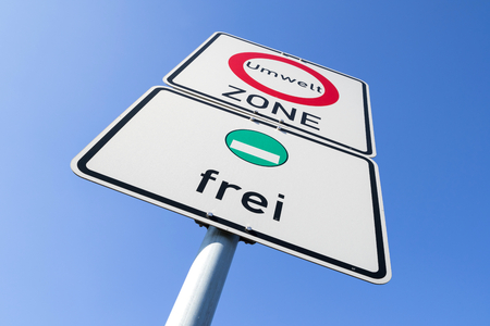 German road sign: start of a low-emission zone, vehicles with green low-emission zone sticker permitted Foto de archivo