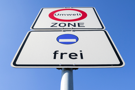 German road sign: start of a low-emission zone, vehicles with fictive blue low-emission zone sticker permitted