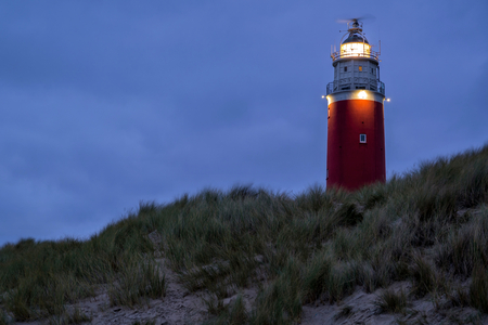 Eierland Lighthouse on the northernmost tip of the Dutch island of Texel after dusk