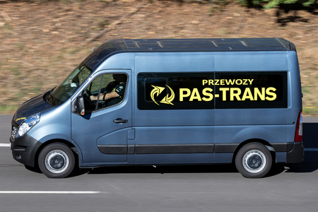Pas-Trans minibus on motorway. Pas-Trans is the largest company in Poland that provides transport services using the door to door method.