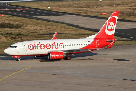 German TUIfly Boeing 737-700 with registration D-AHXG in Air Berlin livery taxiing to terminal at Cologne Bonn Airport.