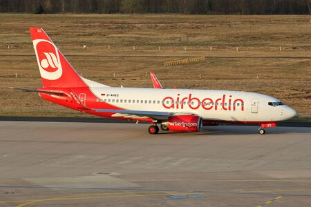 German TUIfly Boeing 737-700 with registration D-AHXG in Air Berlin livery taxiing to runway 14L at Cologne Bonn Airport. Editorial