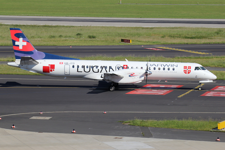 Swiss Darwin Saab 2000 in special Lugano livery with registration HB-IYD on taxiway of Dusseldorf Airport. Darwin ceased operations on 12 December 2017. 写真素材 - 117054614