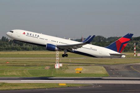 Delta Air Lines Boeing 767-300 with registration N1607B just airborne at Dusseldorf Airport.