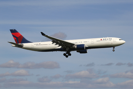 Delta Air Lines Airbus A330-300 with registration N817NW on short final for runway 06 of Amsterdam Airport Schiphol.