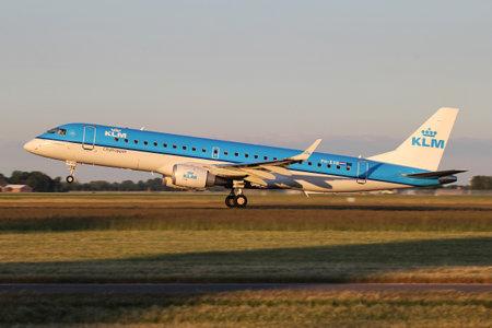 Dutch KLM cityhopper Embraer ERJ-190 with registration PH-EXB just airborne at Amsterdam Airport Schiphol.
