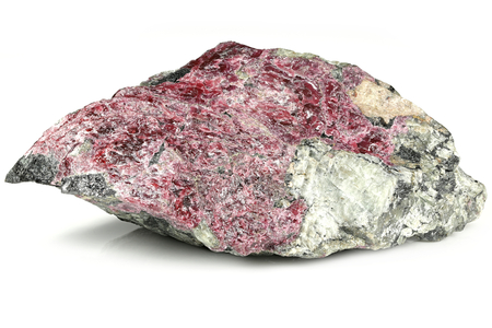eudialyte in matrix from Kola Peninsula, Russia isolated on white background