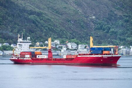 Containership RUMBA in the port of Alesund. Alesund is a town and municipality in More og Romsdal county, Norway. 報道画像