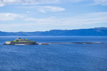 Islet Munkholmen north of Trondheim, Norway. Munkholmen is a popular tourist attraction and recreation site. Reklamní fotografie - 120545209