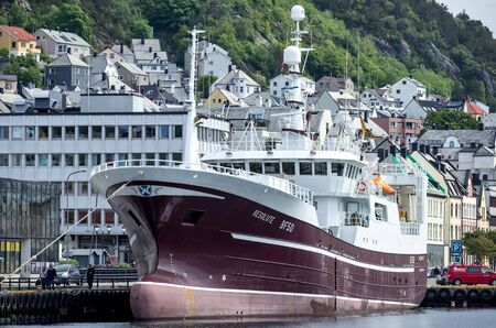 Scottish midwater trawler RESOLUTE BF50 in Alesund, Norway. RESOLUTE is a member of the Scottish Pelagic Sustainability Group. Фото со стока - 129745149