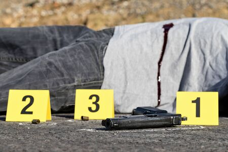 ID tents at crime scene after gunfight Stock Photo