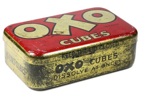 Vintage OXO cubes tin isolated on white background.  OXO is a brand of food products, including stock cubes, herbs and spices, dried gravy, and yeast extract.