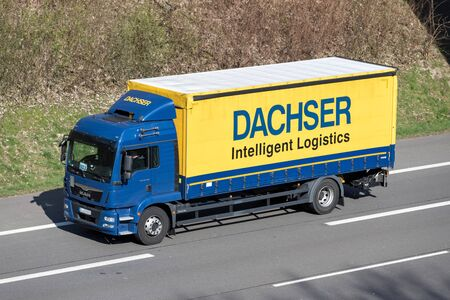 Dachser truck on motorway. Dachser is a German logistics company, founded by Thomas Dachser in 1930, with its headquarters in Kempten in the Allgäu region. Stock Photo - 129745164