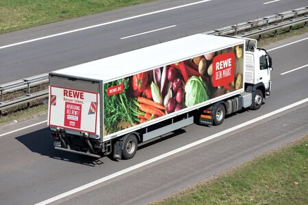 REWE truck on motorway. REWE operates approximately 3,300 supermarkets in Germany.