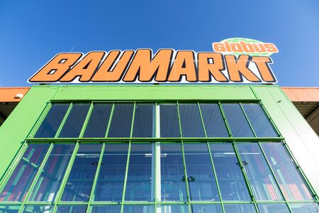 Globus Baumarkt sign at store. Globus is a German retail chain of hypermarkets, DIY stores and electronics stores.