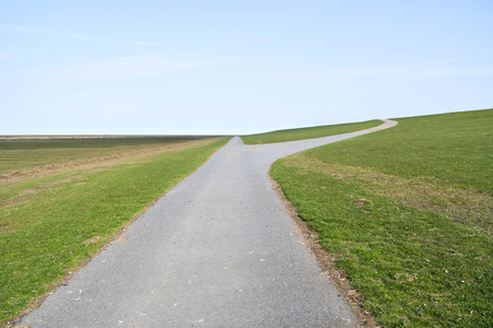 way to and parallel to a dike in North Frisia, Germany Stockfoto - 121789608