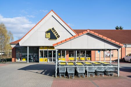 Netto Lebensmitteldiscounter branch. Netto is a Danish discount supermarket operating in Denmark, Germany, Poland and Sweden. Фото со стока - 129745249