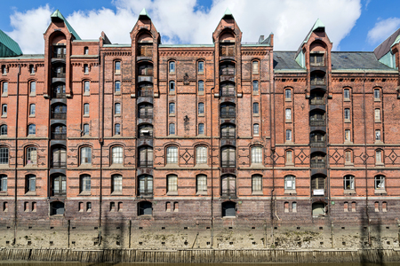 Speicherstadt in Hamburg, Germany. It is the largest warehouse district in the world where the buildings stand on timber-pile foundations and was awarded the status of World Heritage in 2015. Stok Fotoğraf