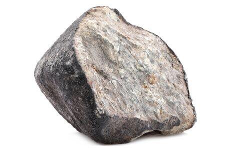 Fragmento del meteorito Chelyabinsk (caído el 15 de febrero de 2013) aislado sobre fondo blanco. Foto de archivo