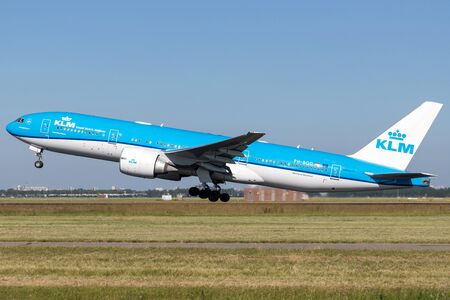 Dutch KLM Boeing 777-200 with registration PH-BQD taking off runway 36L (Polderbaan) of Amsterdam Airport Schiphol. Editöryel