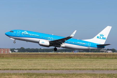 Dutch KLM Boeing 737-800 with registration PH-BXW taking off runway 36L (Polderbaan) of Amsterdam Airport Schiphol.