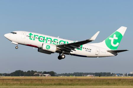Dutch Transavia Boeing 737-700 with registration PH-XRD taking off runway 36L (Polderbaan) of Amsterdam Airport Schiphol. 에디토리얼