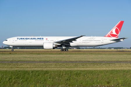 Turkish Airlines Boeing 777-300 with registration TC-LJC on take off roll on runway 36L (Polderbaan) of Amsterdam Airport Schiphol.
