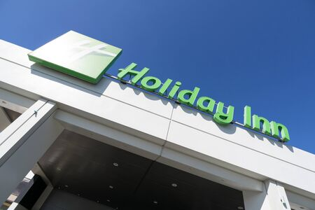 Holiday Inn Hotel in Leiden, The Netherlands. Holiday Inn is a British-owned American brand of hotels, and a subsidiary of InterContinental Hotels Group. Redakční