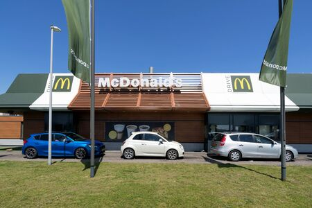 McDonald's McDrive drive-through service. McDonald's is an American hamburger and fast food restaurant chain, founded in 1940. Redakční