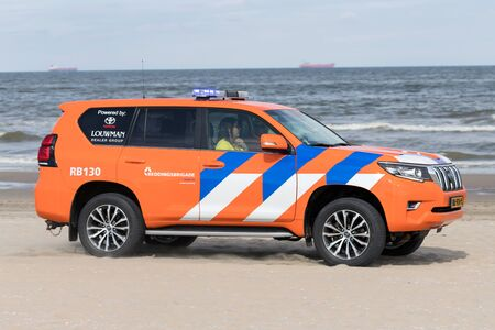 Dutch lifeguard Toyota Land Cruiser with active blue emergency lighting on the beach