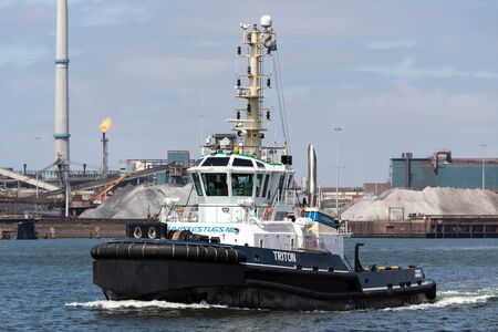 Tugboat TRITON in IJmuiden, The Netherlands. Iskes Towage and Salvage has been providing Harbour Towage Services in IJmuiden since 1928.