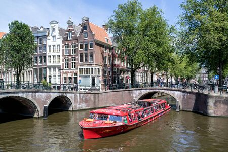 Amsterdam canal boat PC HOOFT of City Sightseeing Amsterdam at Keizersgracht/ Leidsegracht intersection.