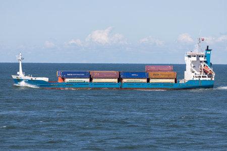 container ship ANJA outbound Rotterdam Редакционное