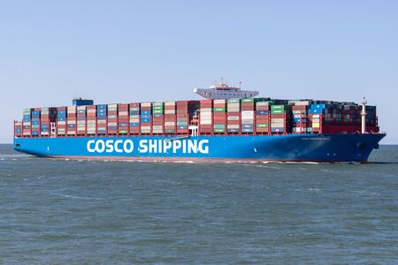 COSCO SHIPPING LIBRA inbound Rotterdam. COSCO is a Chinese state-owned shipping and logistics services supplier company. Редакционное