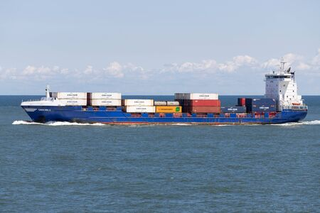 container ship ENSEMBLE outbound Rotterdam Редакционное