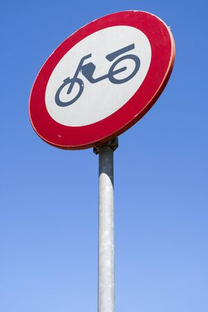 Dutch road sign: no access for mopeds, motor-assisted bicycles or motor-powered invalid carriages