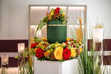 urn within coronal on funeral Stock Photo