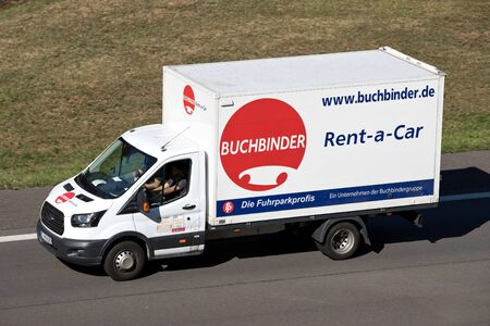 Ford Transit of Buchbinder on motorway. Buchbinder is a German car rental company and part of the French Europcar Mobility Group. Editorial