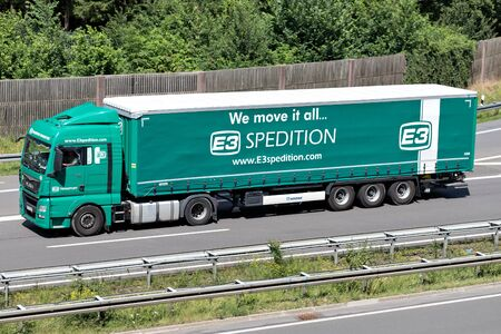 E3 Spedition MAN TGX truck with curtainside trailer on motorway.