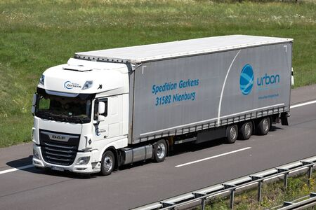 Spedition Gerkens DAF XF truck with curtainside trailer on motorway. Editorial