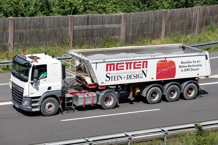 Metten DAF CF truck with tipper trailer on motorway.