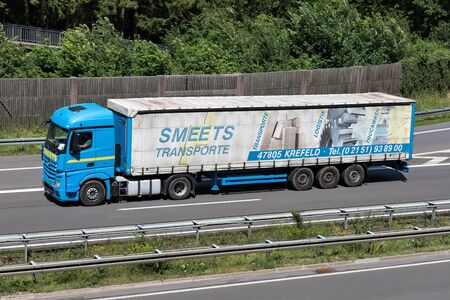 Smeets Mercedes-Benz Actros truck with curtainside trailer on motorway. Editorial