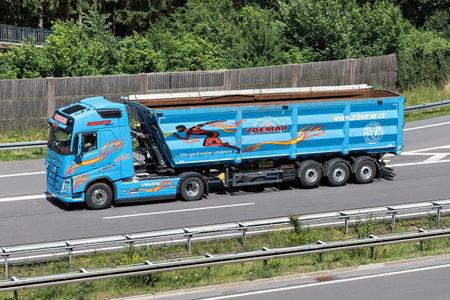 Zdemar Volvo FH truck with bulk trailer on motorway. Editorial
