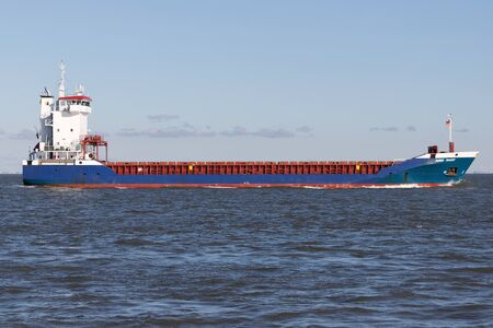 general cargo vessel AMBER TRADER on the river Elbe