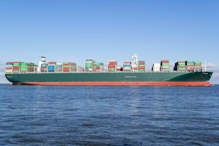 Container ship EVER GOODS on the river Elbe. Evergreen headquartered in Taiwan is a global containerized-freight shipping company. Editoriali