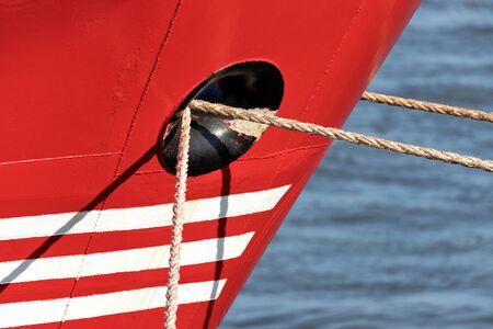 mooring ropes through hawsehole of a freight ship Stok Fotoğraf